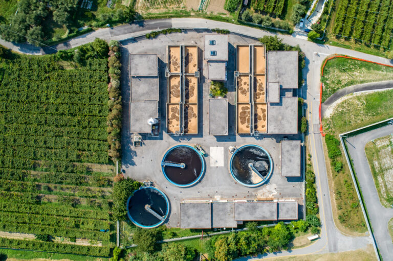 Aerial view of wastewater treatment plant and farm land